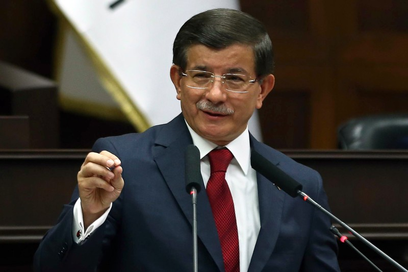 Turkey's Prime Minister Ahmet Davutoglu delivers a speech during the parliamentary group meeting of the Justice and Development Party at the Grand National Assembly of Turkey (TBMM) in Ankara on July 29, 2015. Turkish warplanes on July 29 pounded targets of PKK militants in northern Iraq, as parliament met in emergency session to debate the government's controversial campaign against Kurdish rebels and jihadists. AFP PHOTO / ADEM ALTAN        (Photo credit should read ADEM ALTAN/AFP/Getty Images)