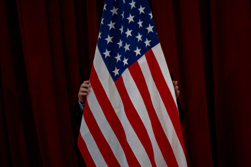 A man arranges a US flag ahead of a joint press conference between US President Barack Obama and Malaysia's Prime Minister Najib Razak at Seri Perdana in Malaysia's administrative capital in Putrajaya on April 27, 2014. Obama arrived in Malaysia for a visit aimed at energising relations with the predominantly Muslim nation and re-focusing an Asian tour repeatedly distracted by foreign-policy crises elsewhere. AFP PHOTO / MOHD RASFAN        (Photo credit should read MOHD RASFAN/AFP/Getty Images)