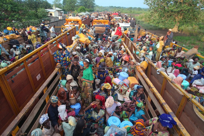 BANGUI, CENTRAL AFRICAN REPUBLIC - APRIL 30:  Muslims fleeing from capital Bangui to Kaga-Bandoro (market town, It is situated 245km north of the capital Bangui), under the protection of members of the Multinational Force of Central Africa (MISCA) in Bangui, Central African Republic on April 29, 2014. (Photo by Nacer Telal/Anadolu Agency/Getty Images)