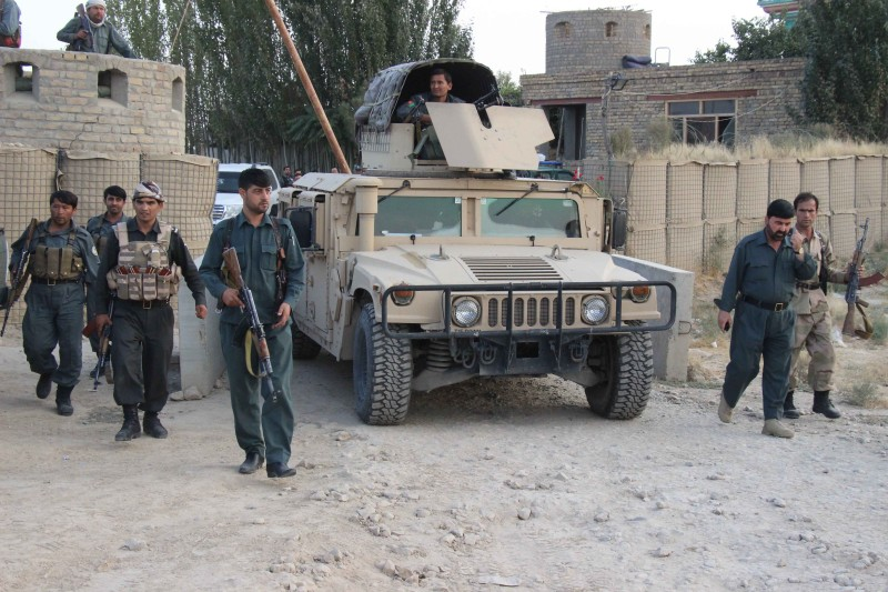 This photograph taken on September 29, 2015 shows Afghan security personnel keeping watch as heavy fighting erupted near the airport on the outskirts of Kunduz. Taliban insurgents who seized the Afghan city of Kunduz have defied a counter-offensive and advanced on the airport where government forces retreated after the fall of the strategic northern gateway. Heavy fighting erupted near the airport on the city's outskirts as the insurgents closed in late on September 29, highlighting the potent challenge the militants represent after their lightning capture of Kunduz the previous day. AFP PHOTO / Nasir Waqif        (Photo credit should read NASIR WAQIF/AFP/Getty Images)