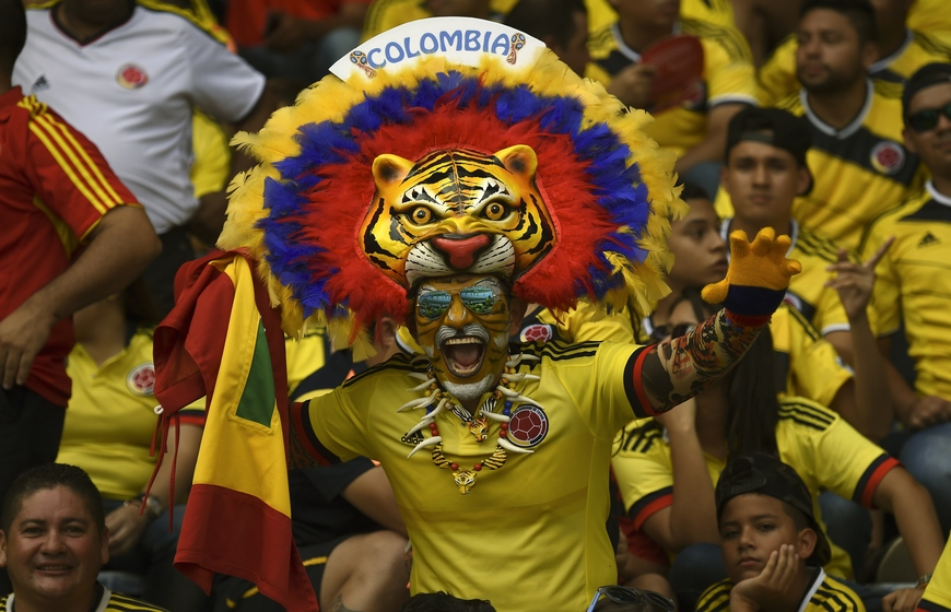 Fans of Colombia cheer for their team before the start of the Russia 2018 FIFA World Cup qualifiers match Colombia vs Peru, at the Metropolitano Roberto Melendez stadium in Barranquilla, Colombia, on October 8, 2015.      AFP PHOTO / LUIS ACOSTA        (Photo credit should read LUIS ACOSTA/AFP/Getty Images)