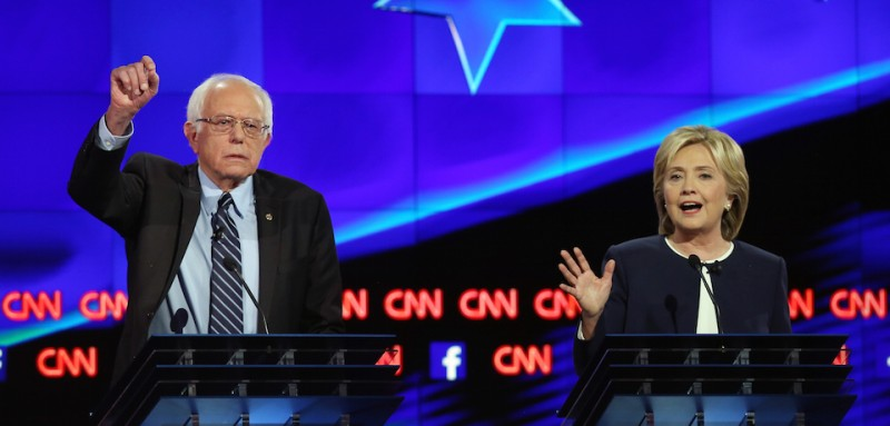 LAS VEGAS, NV - OCTOBER 13:  Democratic presidential candidates Sen. U.S. Bernie Sanders (I-VT) (L) and Hillary Clinton take part in a presidential debate sponsored by CNN and Facebook at Wynn Las Vegas on October 13, 2015 in Las Vegas, Nevada. Five Democratic presidential candidates are participating in the party's first presidential debate.  (Photo by Joe Raedle/Getty Images)