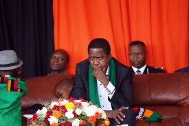 Zambian President Edgar Chagwa Lungu looks on as thousands of Zambians rally to pray against the depreciation of the countrys currency and economic crisis at the Show grounds in the capital city Lusaka on October 18, 2015. Food prices have soared and crippling power shortages have also been triggered by low water-levels in Lake Kariba, where hydropower plants supply much of the country's electricity.  AFP PHOTO/SALIM DAWOOD        (Photo credit should read SALIM DAWOOD/AFP/Getty Images)