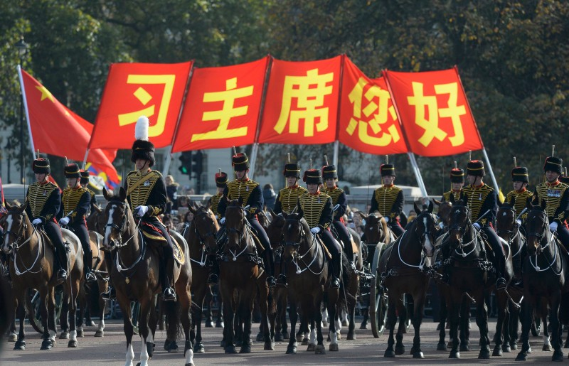 LONDON, UNITED KINGDOM - OCTOBER 20:  Members of the cavalry parade down the Mall during the visit of China's President Xi Jinping on October 20, 2015 in London, England. The President of the Peoples Republic of China, Mr Xi Jinping and his wife, Madame Peng Liyuan, are paying a State Visit to the United Kingdom as guests of The Queen.  They will stay at Buckingham Palace and undertake engagements in London and Manchester. The last state visit paid by a Chinese President to the UK was Hu Jintao in 2005.  (Photo by Toby Melville - WPA Pool/Getty Images)