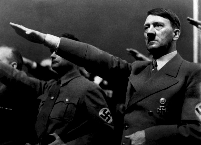 "A picture dated 1939 shows German Nazi Chancellor Adolf Hitler giving the nazi salute during a rally next to ""Deputy Furhrer"" Rudolf Hess. AFP PHOTO / FRANCE PRESSE VOIR (Photo credit should read -/AFP/Getty Images)"