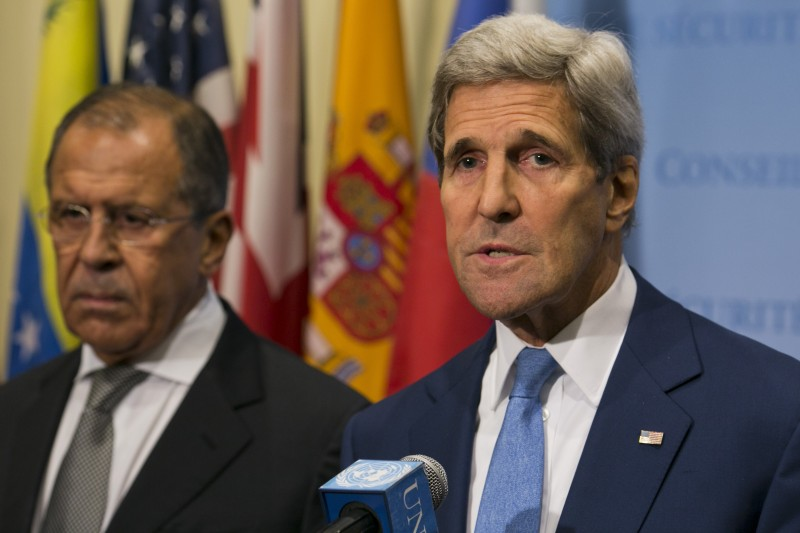 """United States Secretary of State John Kerry and Russia Foreign Minister Sergey Lavrov speak to the media after a meeting concerning Syria at the United Nations headquarters in New York on September 30, 2015. Russia's air strikes in Syria targeted opposition forces and not Islamic State jihadists, a US defense official said, contradicting Russian claims. At the United Nations in New York, Secretary of State John Kerry made clear that Washington would have """"grave concerns"""" should Moscow opt to strike targets in areas where IS fighters and Al-Qaeda-linked groups are not operating. AFP PHOTO/Dominick Reuter        (Photo credit should read DOMINICK REUTER/AFP/Getty Images)"""