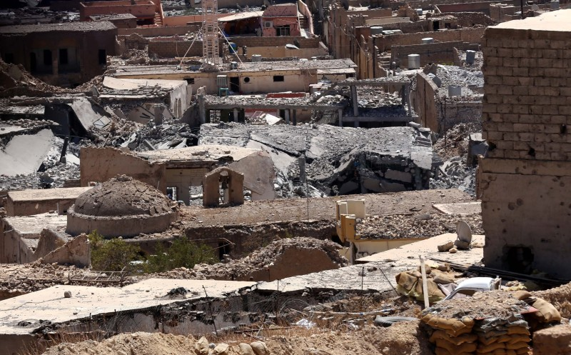 A picture taken on August 17, 2015 shows buildings that were damaged during fighting between Iraqi Kurdish Peshmerga fighters and the Islamic State (IS) group's militants in the northern Iraqi town of Sinjar, west of the city of Mosul.  AFP PHOTO / SAFIN HAMED        (Photo credit should read SAFIN HAMED/AFP/Getty Images)