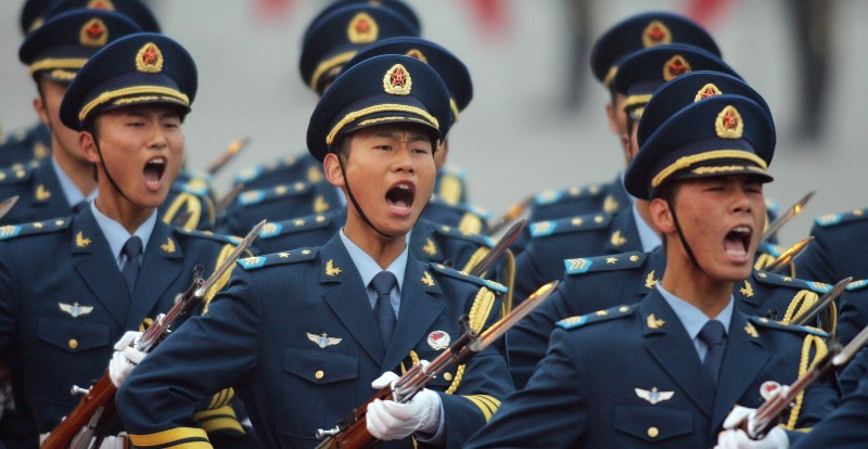 (FILES) This file photo taken on October 24, 2007 shows members of the Chinese Navy, a division of the People's Liberatiuon Army (PLA), shouting while marching during a welcoming ceremony at the Great Hall of the People in Beijing. China is extending its military advantage over Taiwan and increasingly looking beyond, building up a force with power to strike in Asia as far afield as the US territory of Guam, the Pentagon said on August 16, 2010.    AFP PHOTO / FILES / Frederic J. BROWN (Photo credit should read FREDERIC J. BROWN/AFP/Getty Images)