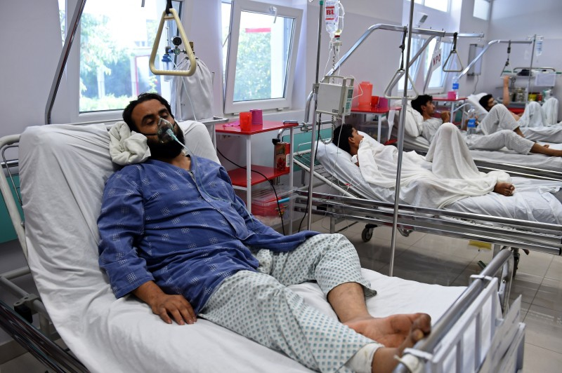 A wounded staff member of Doctors Without Borders (MSF), (L), survivor of the US airstrikes on the MSF Hospital in Kunduz, receives treatment at the Italian aid organization, Emergency's hospital in Kabul on October 6, 2015.    Afghan forces called in a US air strike on a Kunduz hospital that killed 22 people, the top American commander in Afghanistan said October 5, 2015, after medical charity MSF branded the incident a war crime.  AFP PHOTO / Wakil Kohsar        (Photo credit should read WAKIL KOHSAR/AFP/Getty Images)