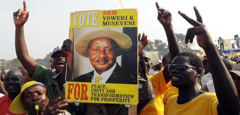 A man in a crowd of supporters holds up a sign portraying the face of Uganda's incumbent president Yoweri Museveni on February 16, 2011 during Museveni's last public rally at Kololo Airstrip in Kampala, two days before the general elections. Uganda entered the final day of campaigning today in elections that will likely secure another term for President Yoweri Museveni, already the longest-serving leader in the region. AFP PHOTO/Simon Maina (Photo credit should read SIMON MAINA/AFP/Getty Images)