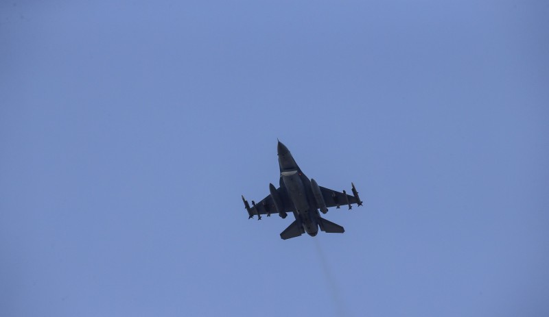 A missile-loaded Turkish Air Force warplane takes off from the Incirlik Air Base, in the outskirts of the city of Adana, southeastern Turkey, on July 28, 2015. After months of reluctance, Turkish warplanes last week started striking militant targets in Syria and agreed to allow the US to launch its own strikes from Turkey's strategically located Incirlik Air Base. In a series of cross-border strikes, Turkey has not only targeted the IS group but also Kurdish fighters affiliated with forces battling IS in Syria and Iraq. AFP PHOTO/STR        (Photo credit should read STR/AFP/Getty Images)
