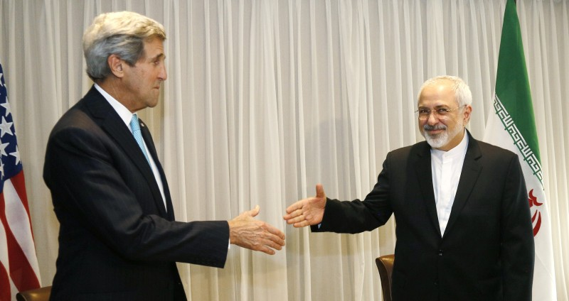 Iranian Foreign Minister Mohammad Javad Zarif shakes hands on January 14, 2015 with US State Secretary John Kerry in Geneva. Zarif said on January 14 that his meeting with US counterpart was vital for progress on talks on Tehran's contested nuclear drive. Under an interim deal agreed in November 2013, Iran's stock of fissile material has been diluted from 20 percent enriched uranium to five percent, in exchange for limited sanctions relief.   AFP PHOTO / POOL / RICK WILKING        (Photo credit should read RICK WILKING/AFP/Getty Images)