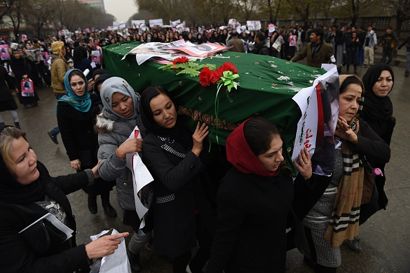 Afghan protesters carry a coffin containing a decapitated body of one of seven Shiite Muslim Hazaras, including four men, two women and one child, during a demonstration in Kabul on November 11, 2015. Thousands of protesters marched coffins containing the decapitated bodies of seven Shiite Hazaras through the Afghan capital Kabul on November 11 to demand justice for the gruesome beheadings, which prompted fears of sectarian bloodshed in the war-torn country. Demonstrators gathered in the rain in west Kabul and marched towards the city centre, chanting death slogans to the Taliban and the Islamic State group while demanding justice and protection from the government. AFP PHOTO / SHAH Marai        (Photo credit should read SHAH MARAI/AFP/Getty Images)