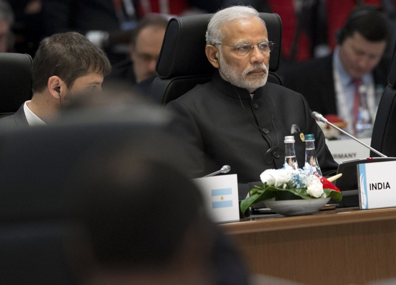 Indian Prime Minister Narendra Modi (R) attends a working session on the Global Economy during the G20 summit in Antalya, on November 15, 2015. Leaders from the world's top 20 industrial powers meet in Turkey from November 15 seeking to overcome differences on a range of issues including the Syria conflict, the refugee crisis and climate change. AFP PHOTO / SAUL LOEB        (Photo credit should read SAUL LOEB/AFP/Getty Images)