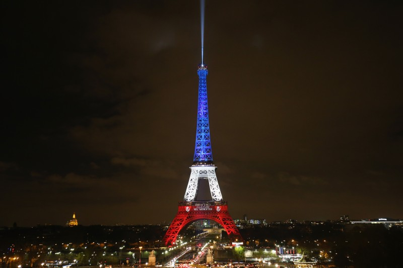 The Eiffel Tower is illuminated in Red, White and Blue in honour of the victims of Friday's terrorist attacks on November 16, 2015 in Paris, France. Countries across Europe joined France today to observe a one minute-silence in an expression of solidarity with the victims of the terrorist attacks, which left at least 129 people dead and hundreds more injured.