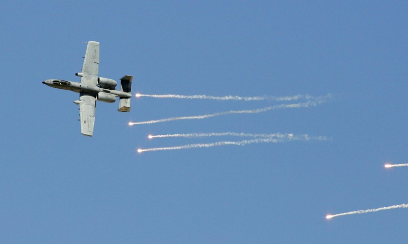 INDIAN SPRINGS, NV - SEPTEMBER 14:  An A-10 Thunderbolt drops flares during a U.S. Air Force firepower demonstration at the Nevada Test and Training Range September 14, 2007 near Indian Springs, Nevada.  (Photo by Ethan Miller/Getty Images)