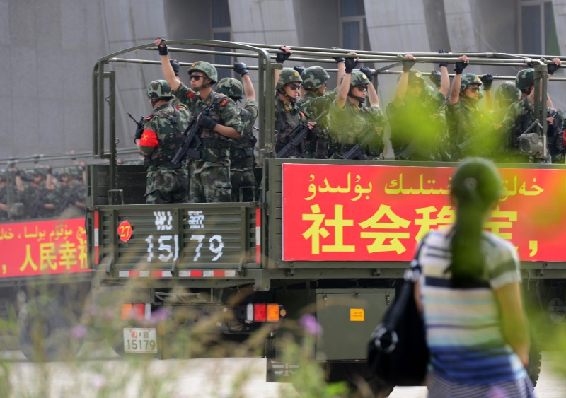 "This picture taken on June 6, 2014 shows security forces participating in a military drill in Hetian, northwest China's Xinjiang region.China vowed a year-long campaign against terrorism, days after attackers in the western region of Xinjiang killed 39 people in a suicide raid. The statement said the campaign would last until June 2015 and is aimed at ""preventing the spread of religious extremism"" from Xinjiang to the country's interior.      CHINA OUT   AFP PHOTO        (Photo credit should read AFP/AFP/Getty Images)"