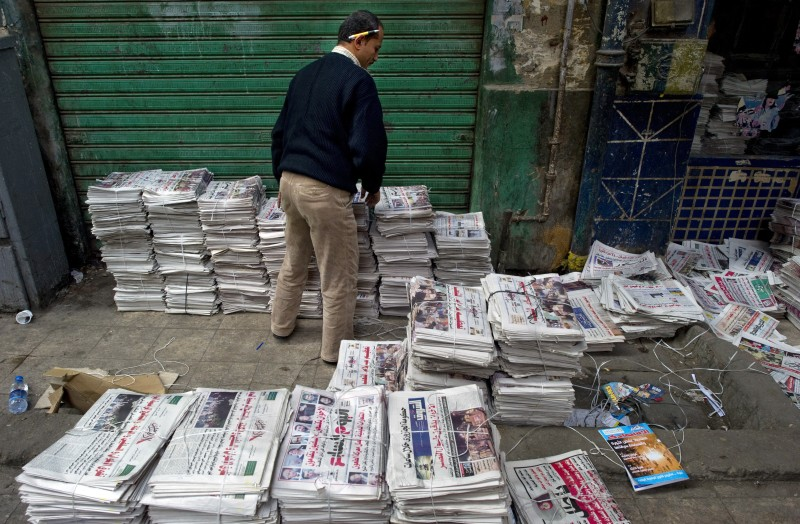 An Egyptian man sorts newspapers at a distribution center just off Cairo's Tahrir Square on December 2, 2011.  Egypt awaited the delayed publication of results for the opening phase of its first elections since the overthrow of veteran president Hosni Mubarak which are expected to confirm an Islamist sweep. AFP PHOTO/ODD ANDERSEN (Photo credit should read ODD ANDERSEN/AFP/Getty Images)