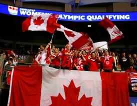 VANCOUVER, CANADA - JANUARY 19:  Canadian fans celebrate a 6-0 win against Haiti during the 2012 CONCACAF Women's Olympic Qualifying Tournament at BC Place on January 19, 2012 in Vancouver, British Columbia, Canada.  (Photo by Jeff Vinnick/Getty Images)