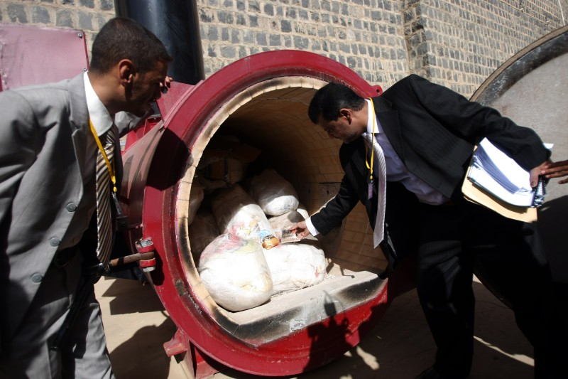 An employee of the public prosecutor's office, the Department of Criminal Evidence, looks at illegal drugs, which are to be set on fire in an incinerator, in Sanaa February 29, 2012. Yemeni authorities burned more than four tons of hashish and 4.6 million tablets of Captagon, which weighed 16kg (35 pounds). AFP PHOTO/ MOHAMMED HUWAIS (Photo credit should read MOHAMMED HUWAIS/AFP/Getty Images)
