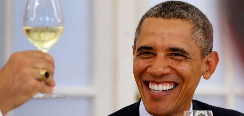 """US President Barack Obama smiles during a state dinner in Berlin,on June 19, 2013. Obama said Russian and US nuclear weapons should be slashed by up to a third in a keynote speech in front of Berlin's iconic Brandenburg Gate in which he called for a world of """"peace and justice"""".  AFP PHOTO /POOL/ MICHAEL SOHN        (Photo credit should read MICHAEL SOHN/AFP/Getty Images)"""