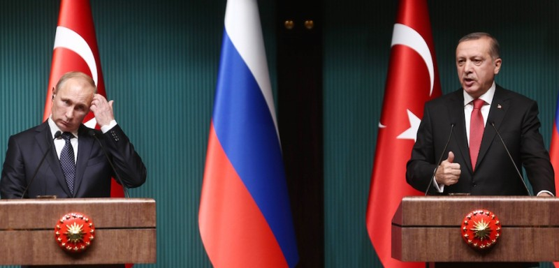 Turkish President Recep Tayyip Erdogan (R) and Russian President Vladimir Putin (L) hold a joint press conference at Turkey's Presidential Palace in Ankara, on December 1, 2014 .  Erdogan on Monday held talks in Ankara with his Russian counterpart Vladimir Putin aimed at boosting trade and strengthening relations, despite sharp differences over the crises in Syria and Ukraine. AFP PHOTO/ADEM ALTAN        (Photo credit should read )
