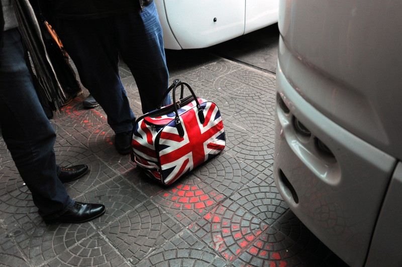 "A bag decorated with the British flag is seen as people prepare to board a bus to London via Germany and France on January 2, 2014 at the central bus station in Sofia. Romanians and Bulgarians have the right to work in any of the European Union's 28 countries starting January 1, 2014 but ""no major increase"" in emigration is expected, the European Commission said on the same day. AFP PHOTO / NIKOLAY DOYCHINOV        (Photo credit should read NIKOLAY DOYCHINOV/AFP/Getty Images)"