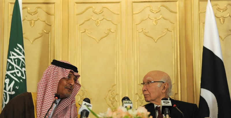 Pakistan's Adviser for National Security and Foreign Affairs Sartaj Aziz (R) speaks with Saudi Foreign Minister, Prince Saud al-Faisal during a joint press conference at the Foreign Ministry in Islamabad on January 7, 2014. Saudi Arabia's foreign minister said on January 7 the kingdom would not intervene to get Pakistan's former ruler Pervez Musharraf out of the country before his trial for treason. Musharraf is facing a special treason tribunal in Islamabad over his imposition of emergency rule in 2007 and could face the death penalty if he is convicted. AFP PHOTO/Aamir QURESHI        (Photo credit should read AAMIR QURESHI/AFP/Getty Images)
