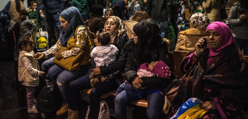 MELILLA, SPAIN - JANUARY 22:  Syrian refugees who were staying at the Temporary Immigration Centre (CETI) wait for getting their passports and tickets at the the Ferry Terminal of Melilla where they will board a cruise bound to Malaga on the Spanish mailland on January 22, 2015 in Melilla, Spain. According to Spanish Police approximately 2,400 from the 5,000 immigrants entering Melilla last year were Syrians seeking asylum in various European countries. The majority of those now housed in Temporary Immigration Centres (CETI) in Ceuta and Melilla have escaped from war in Syria. According to the last official figures released by the Spanish Authorities, 1,300 immigrants are living at the Temporary Immigration Centre of Melilla, four times its capacity of 480 people. About 840 Syrian refugees are among them outnumbering Sub-Sahara immigrants for the first time since these camps were built. (Photo by David Ramos/Getty Images)
