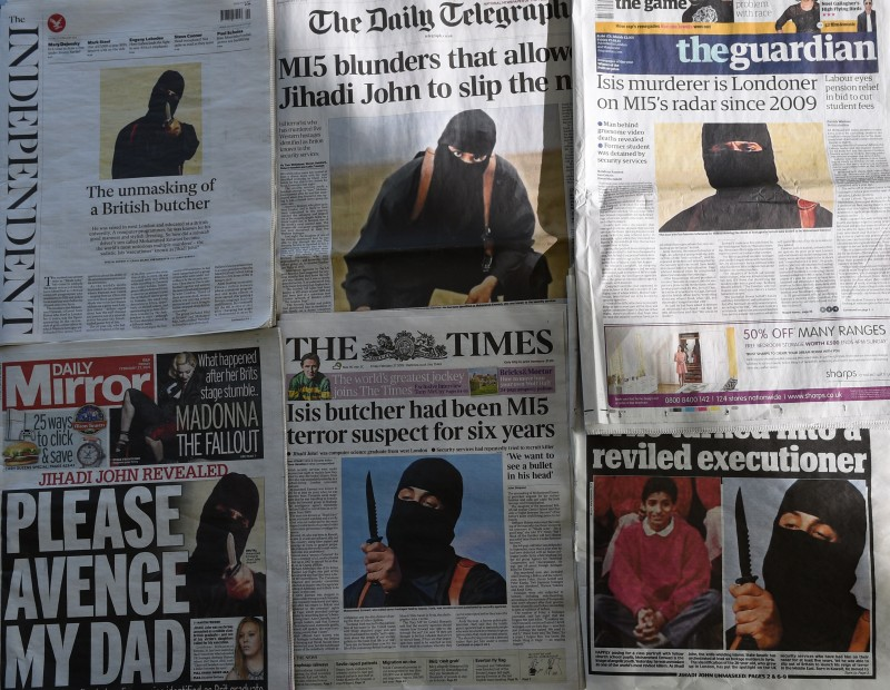 "An arrangment of British daily newspapers photographed in London on February 27, 2015 shows the front-page headlines and stories regarding the identification of the masked Islamic State group militant dubbed ""Jihadi John"". The British headlines were dominated on Febryary 27 by the story of the identification of the Islamic State executioner. ""Jihadi John"", the masked Islamic State group militant believed responsible for beheading of at least five Western hostages, has been named as Kuwaiti-born computing graduate Mohammed Emwazi from London.  AFP PHOTO / DANIEL SORABJI        (Photo credit should read DANIEL SORABJI/AFP/Getty Images)"