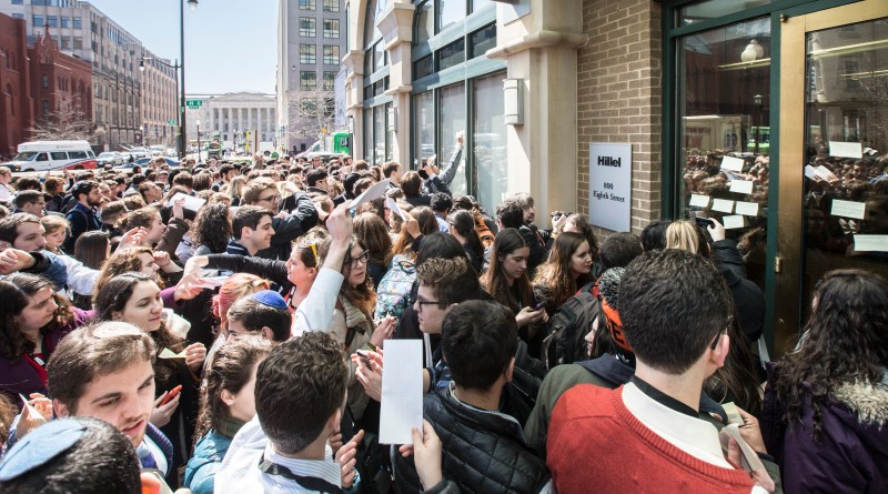 WASHINGTON, DC - MARCH 23: Hundreds of J Street U students rush towards the doors of Hillel International to put up post-it notes in a response to Hillel President Eric Fingerhut canceling his scheduled speech at their conference. (Erin Schaff/For The Washington Post via Getty Images)