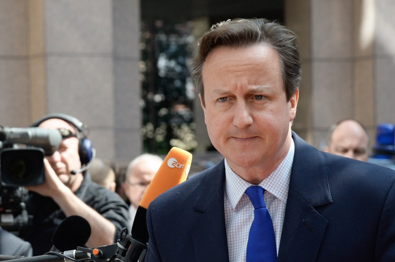 Britain's Prime minister David Cameron arrives at the European Council headquarters for an extraordinary summit of European leaders to deal with a worsening migration crisis, on April 23, 2015 in Brussels. European leaders gather on April 23 to consider military action, at an extraordinary summit to deal with a worsening migration crisis after a series of deadly shipwrecks in the Mediterranean.   AFP PHOTO / THIERRY CHARLIER        (Photo credit should read THIERRY CHARLIER/AFP/Getty Images)