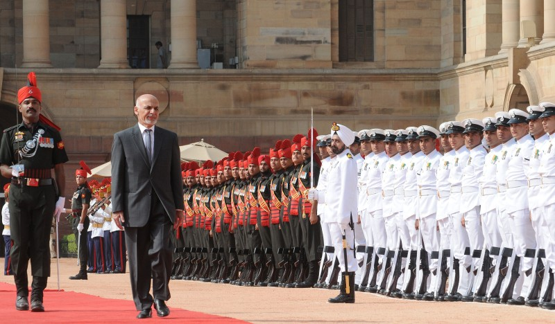 Afghan President Ashraf Ghani inspects a guard of honour of Indian troops during a Ceremonial Reception at Rashtrapati Bhavan in New Delhi on April 28, 2015. Ghani is on a three day visit to India.    AFP PHOTO/STR        (Photo credit should read STRDEL/AFP/Getty Images)