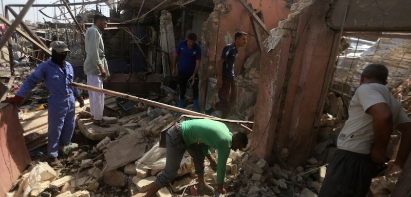 Iraqi men search through the rubble of buildings in the aftermath of a massive suicide car bomb attack carried out by the Islamic State group in the predominantly Shiite town of Khan Bani Saad, 20 km north of Baghdad, on July 18, 2015. The suicide attack by the IS group was one of the deadliest since it took over swathes of Iraq last year and came as the country marked Eid al-Fitr, the Muslim feast that ends the fasting month of Ramadan. AFP PHOTO / AHMAD AL-RUBAYE        (Photo credit should read AHMAD AL-RUBAYE/AFP/Getty Images)