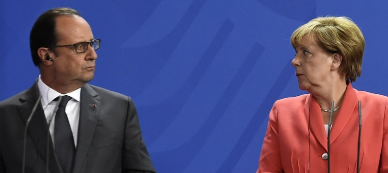 French President Francois Hollande (L) and German Chancellor Angela Merkel (R) address a press conference with the Ukrainian President following talks at the chancellery in Berlin on August 24, 2015. Merkel and Hollande have put enormous political onus on resolving Ukraine's 16-month pro-Russian uprising and returning peace to the European Union's turbulent eastern front. AFP PHOTO / TOBIAS SCHWARZ        (Photo credit should read TOBIAS SCHWARZ/AFP/Getty Images)