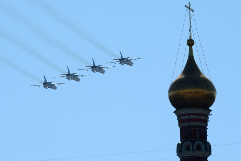 Russian Sukhoi Su-24 all-weather attack aircraft fly above the Kremlin's cathedrals in Moscow, on May  9, 2014, during a Victory Day parade. Thousands of Russian troops marched today in Red Square to mark 69 years since victory in World War II in a show of military might amid tensions in Ukraine following Moscow's annexation of Crimea. AFP PHOTO / KIRILL KUDRYAVTSEV        (Photo credit should read KIRILL KUDRYAVTSEV/AFP/Getty Images)