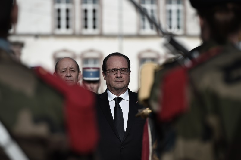 French President Francois Hollande (R) and French Defence Minister Jean-Yves Le Drian (L) review a military honour guard as they attend the inauguration of a Voluntary Military Service in Montigny-lès-Metz, eastern France on October 29, 2015. The centre that is particularly aimed at young people in difficulty opened its doors on October 15, 2015. AFP PHOTO / FREDERICK FLORIN        (Photo credit should read FREDERICK FLORIN/AFP/Getty Images)