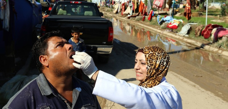 An Iraqi man receives a dose of cholera vaccine at the jamiyah district in Baghdad, on November 1, 2015.  The number of cholera cases in Iraq has risen to more than 1,800 and authorities have blamed the cholera outbreak mostly on the poor quality of water caused by the low level of the Euphrates. AFP PHOTO / SABAH ARAR        (Photo credit should read SABAH ARAR/AFP/Getty Images)