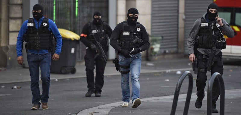 Members of the Raid, a special intervention unit of the French police patrol in the northern Paris suburb of Saint-Denis city center, on November 18, 2015, as French Police special forces raid an appartment, hunting those behind the attacks that claimed 129 lives in the French capital five days ago. At least one person was killed in an apartment targeted in the operation aimed at the suspected mastermind of the attacks, Belgian Abdelhamid Abaaoud, and police had been wounded in the shootout. AFP PHOTO / LIONEL BONAVENTURE        (Photo credit should read LIONEL BONAVENTURE/AFP/Getty Images)