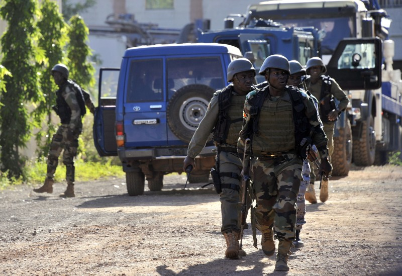 Malian troops take position near the Radisson Blu hotel in Bamako on November 20, 2015. Gunmen went on a shooting rampage at the luxury hotel in Mali's capital Bamako, seizing 170 guests and staff in an ongoing hostage-taking that has left at least three people dead. AFP PHOTO / HABIBOU KOUYATE        (Photo credit should read HABIBOU KOUYATE/AFP/Getty Images)