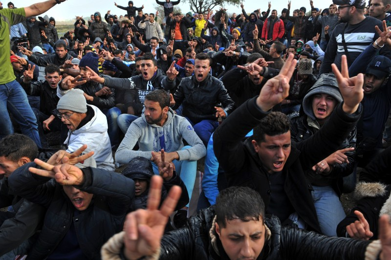 Moroccan refugees and migrants demonstrate as they wait to cross the Greece-Macedonia border near Idomeni on November 24, 2015. Since last week, Macedonia has restricted passage to northern Europe to only Syrians, Iraqis and Afghans who are considered war refugees. All other nationalities are deemed economic migrants and told to turn back. Over 1,500 people are stuck on the border, mostly Iranians, Moroccans, Bangladeshis and Pakistanis. AFP PHOTO / SAKIS MITROLIDIS / AFP / SAKIS MITROLIDIS        (Photo credit should read SAKIS MITROLIDIS/AFP/Getty Images)