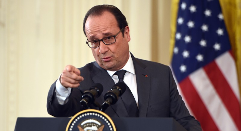 French President Francois Hollande speaks during a joint press conference with US President Barack Obama at the White House in Washington, DC, on November 24, 2015.   AFP PHOTO/NICHOLAS KAMM / AFP / NICHOLAS KAMM        (Photo credit should read NICHOLAS KAMM/AFP/Getty Images)