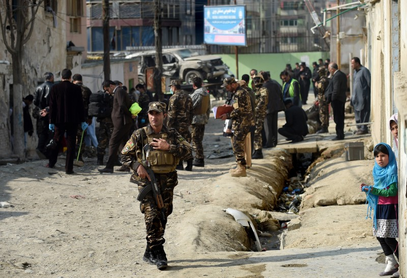 Afghan security forces inspect the scene of a suicide bomb attack which targeted the regional director at the Independent Election Commission, Awal Rehman Rodwal, in Kabul on November 28, 2015.  A senior member of Afghanistan's election commission survived an assassination attempt when a suicide bomber targeted his vehicle in Kabul, killing one of his employees and wounding two others, officials said.  AFP PHOTO / Wakil Kohsar / AFP / WAKIL KOHSAR        (Photo credit should read WAKIL KOHSAR/AFP/Getty Images)