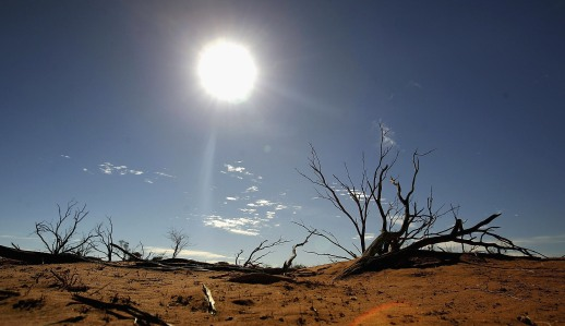 MARREE, AUSTRALIA - JUNE 07: A file photo shows the sun shining on the outback landscape June 7, 2005 near Marree, Australia. An Australian Federal Government report has found that Australian coastal cities and tourist destinations are facing a much higher risk of the destructive effect of climate change resulting in severe storms. The report concludes that likely scenarios include the Australian continent warming by between 1 and 6 degrees by 2070, more droughts which could cut farm output by billions of dollars, tourism suffering from damage to reefs, rainforests and beaches and an increased risk of more tropical cyclones, and longer growing seasons, fewer frosts and higher rainfall in some areas which could help some agribusinesses but adversely affect others from less rainfall. (Photo by Ian Waldie/Getty Images)