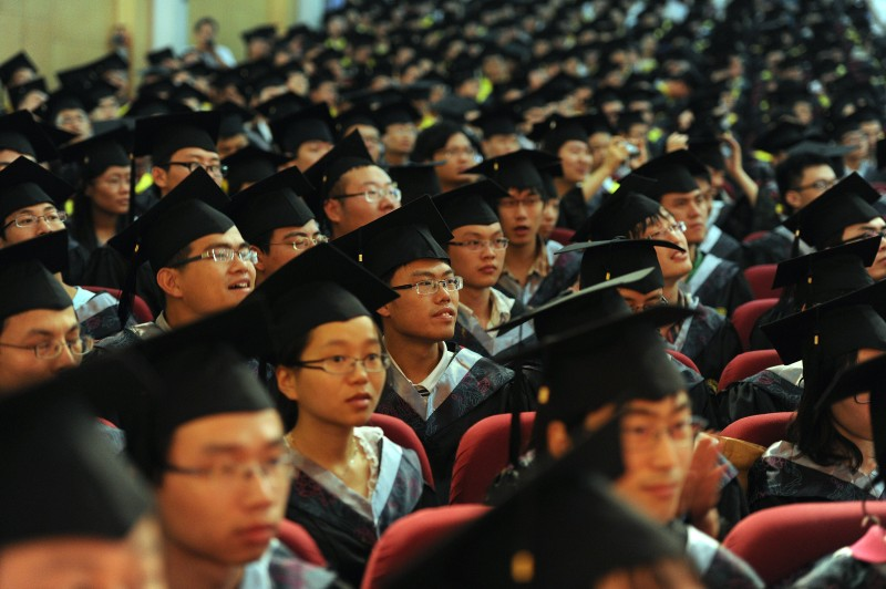 Newly graduated Chinese students gather for a convocation ceremony at the University of Science and Technology in Hefei in east China's Anhui province on June 20, 2012. A record 6.8 million Chinese students, most of them born in 1990, are graduating from Chinese colleges this summer, as increasing number of graduates find it tough to get the right job because there are not enough openings for graduates in the major cities. CHINA OUT AFP PHOTO        (Photo credit should read STR/AFP/GettyImages)