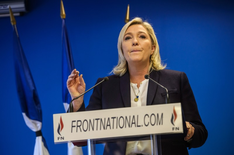 epa05024948 French far-right party Front National (FN) president Marine Le Pen delivers a statement at a press conference at FN's headquarters in Nanterre, France, 14 November, 2015. Le Pen suspends her election campaign at the 13 November Paris attacks that left at least 120 people dead. Eight assailants were killed, seven when they detonated their explosive belts, and one when he was shot by officers, police said. The French government declared a state of emergency, tightened border controls and mobilized 1,500 soldiers in consequence to the 13 November Paris attacks  EPA/CHRISTOPHE PETIT TESSON FINLAND OUT