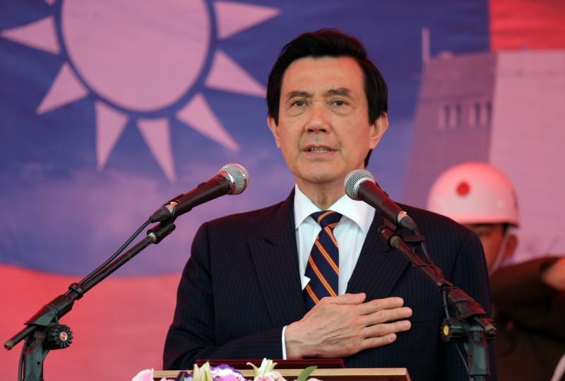 Taiwan President Ma Ying-jeou salutes during a ceremony at Tsoying navy base in southern Kaohsiung on March 31, 2015.  Ma presided over a ceremony that saw Taiwan's biggest missile boat and a locally built logistic support vessel be put to service.  AFP PHOTO / Sam Yeh        (Photo credit should read SAM YEH/AFP/Getty Images)