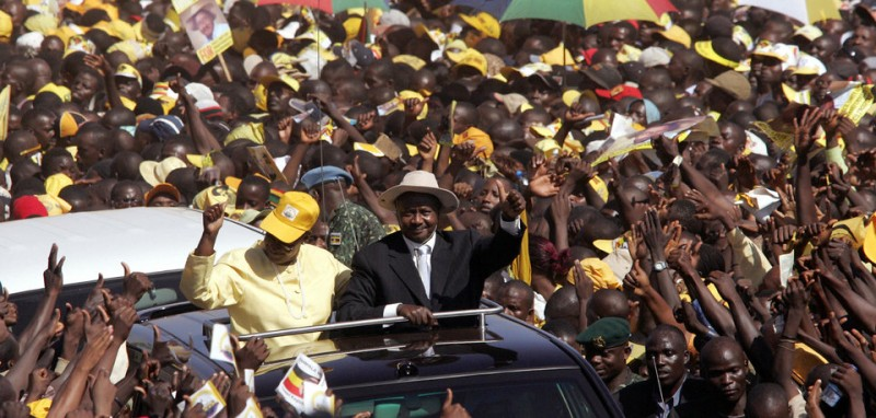 Kampala, UGANDA:  Ugandan President Yoweri Kaguta Museveni greets supporters as he, together with his wife Janet, arrives at the final election rally in Kampala 21 February 2006. Ugandans go to the polls to cast there vote 23Febraury in the country's first multi-party  presidential elections  since 1980. Musesveni is presidential candidate for the ruling party National Resistance Movement (NRM) the main challenge is from  Kizza Besigye of the Forum for Democratic Change leader (FDC) .  AFP PHOTO/ALEXANDER JOE  (Photo credit should read ALEXANDER JOE/AFP/Getty Images)
