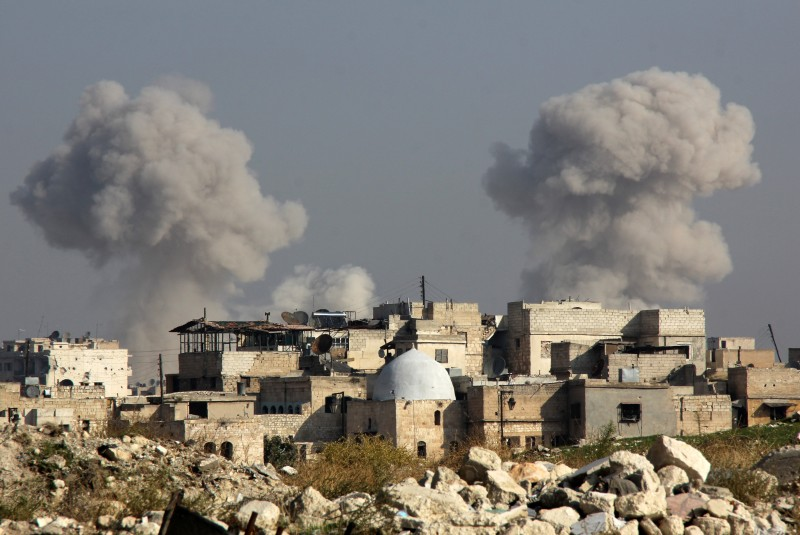 Smoke billows following a reported airstrike by government forces in the northern Syrian city of Aleppo on November 7, 2015. More than 250,000 people have died in Syria's conflict, which several rounds of diplomatic pushes have failed to end. AFP PHOTO / KARAM AL-MASRI        (Photo credit should read KARAM AL-MASRI/AFP/Getty Images)