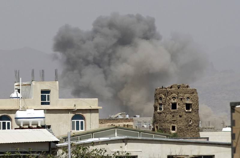 Smoke billows from buildings after reported air-strikes by the Saudi-led coalition on arms warehouses at al-Dailami air base, controlled by Yemeni Iran-backed Shiite Huthi rebels and their allies, on September 6, 2015, north of the capital Sanaa. Powerful explosions shook the Yemeni capital, witnesses said, after the Saudi-led coalition vowed to press its air war following a rebel missile strike that killed dozens of Gulf soldiers.   AFP PHOTO / MOHAMMED HUWAIS        (Photo credit should read MOHAMMED HUWAIS/AFP/Getty Images)